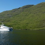 the tour boat passing the north shore of beautiful Killary Fjord